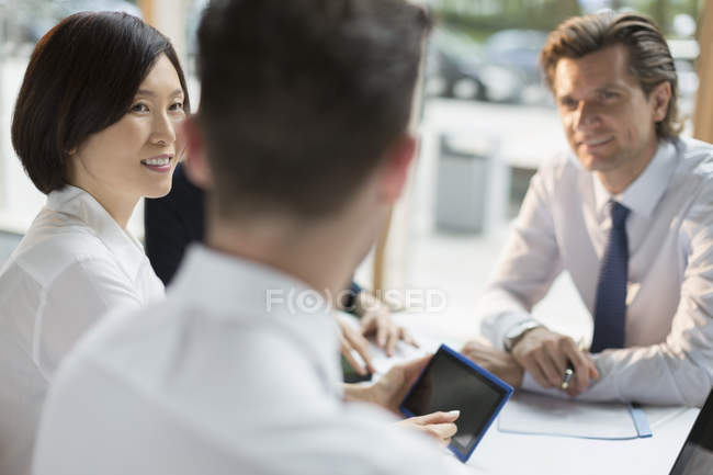 Business people with digital tablet talking in meeting — Stock Photo
