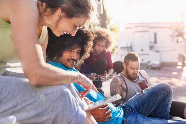 Friends hanging out using digital tablet — Stock Photo
