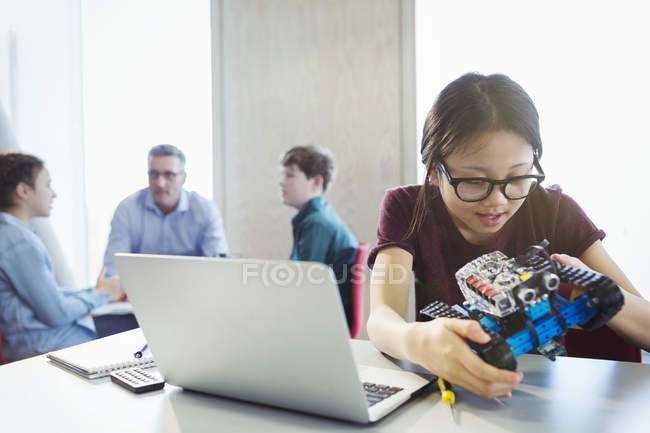 Girl student programming and assembling robotics in classroom — Stock Photo