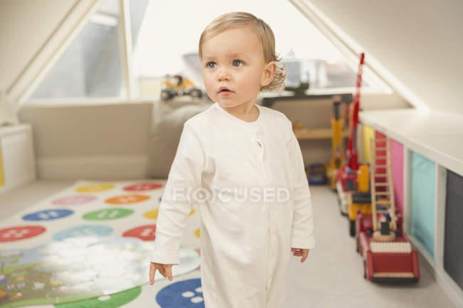 Cute toddler boy looking away in playroom — Stock Photo