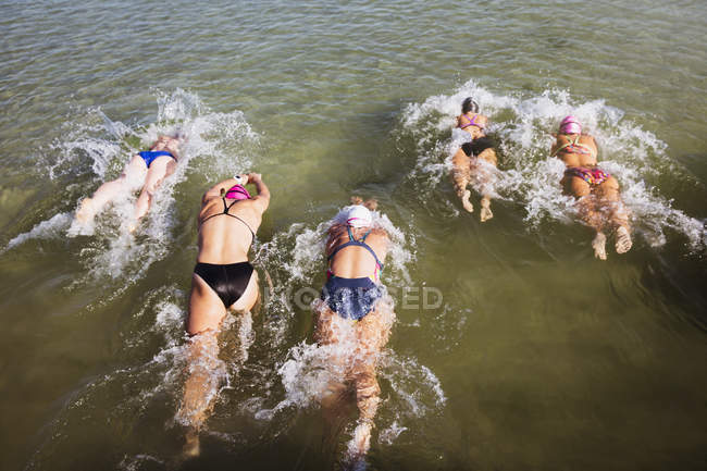 Overhead view of Female active swimmers at ocean outdoors — Stock Photo