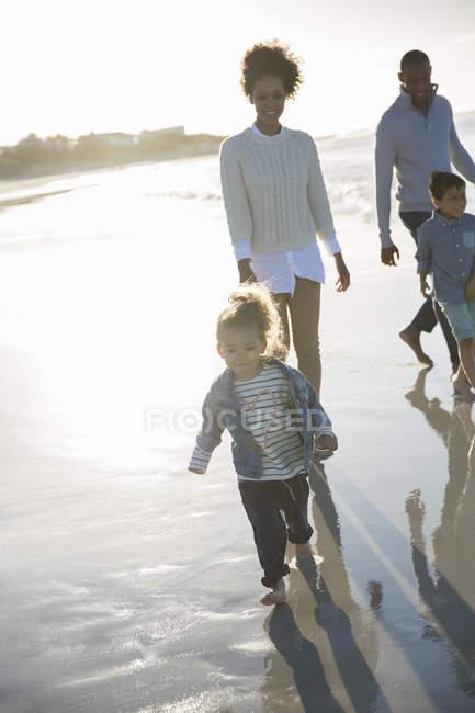 Happy walking on beach at sunset — Stock Photo