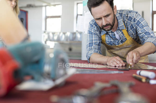Stained glass artist working in modern art studio — Stock Photo