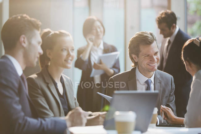 Smiling business people in meeting — Stock Photo