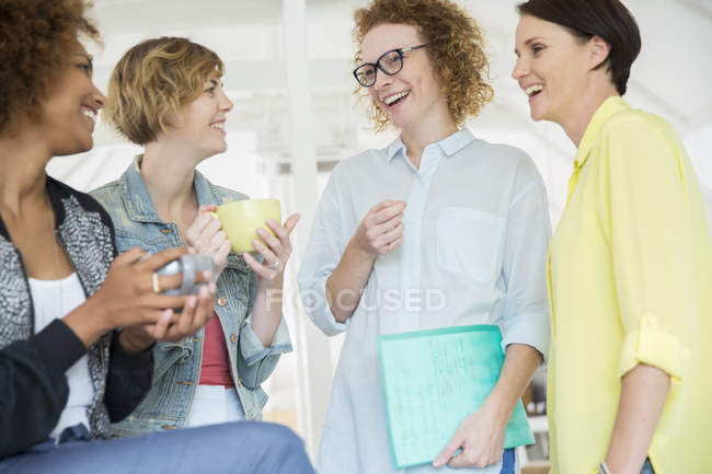 Portrait of laughing office workers in modern office — Stock Photo