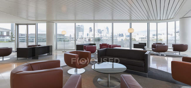 Leather furniture in urban highrise office lounge — Stock Photo