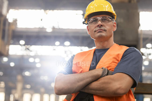 Portrait serious confident steel worker in factory — Stock Photo