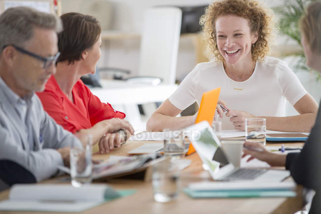 People talking and smiling during business meeting — Stock Photo