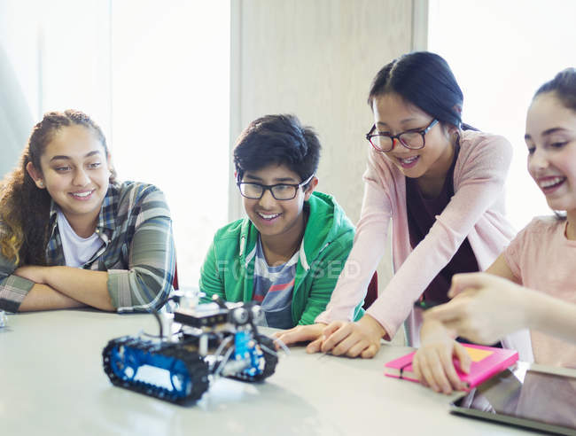 Students programming and testing robotics in classroom — Stock Photo