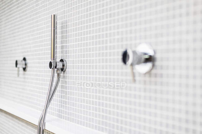Close up modern, minimalist home showcase shower faucet — стоковое фото