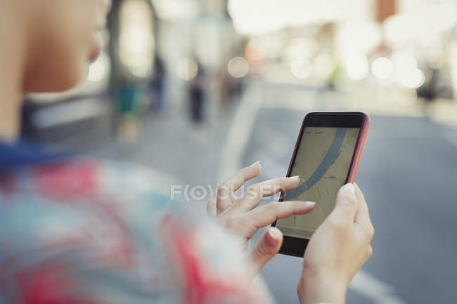 Close up woman using smart phone GPS on street — Stock Photo