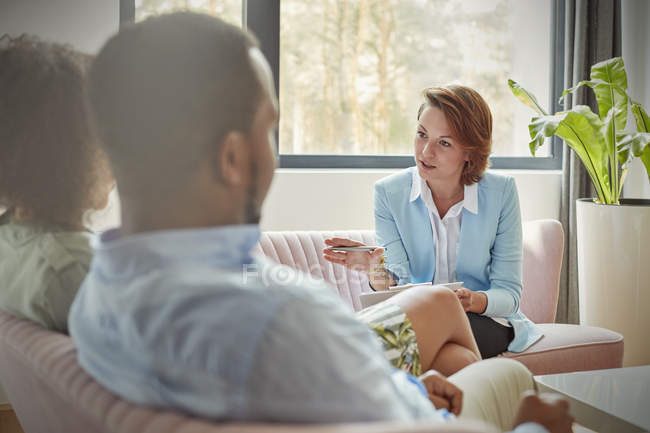 Therapist talking to couple in couples therapy session — Stock Photo