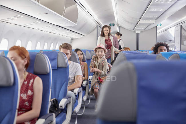 Eager girl boarding airplane — Stock Photo