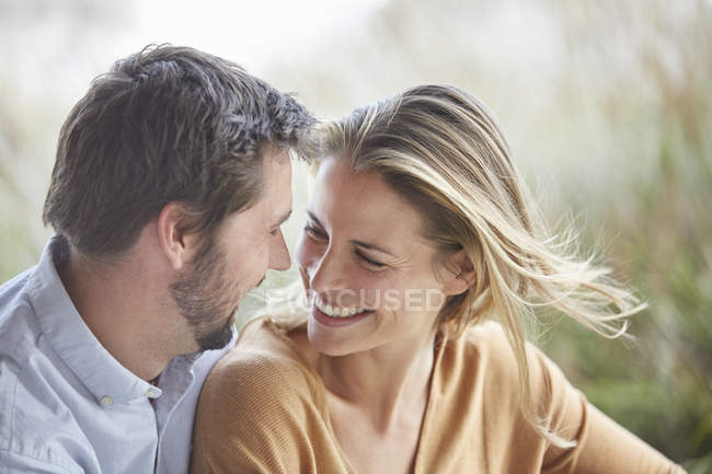 Smiling affectionate couple face to face — Stock Photo