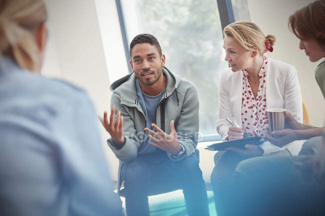 Man talking in group therapy session — Stock Photo