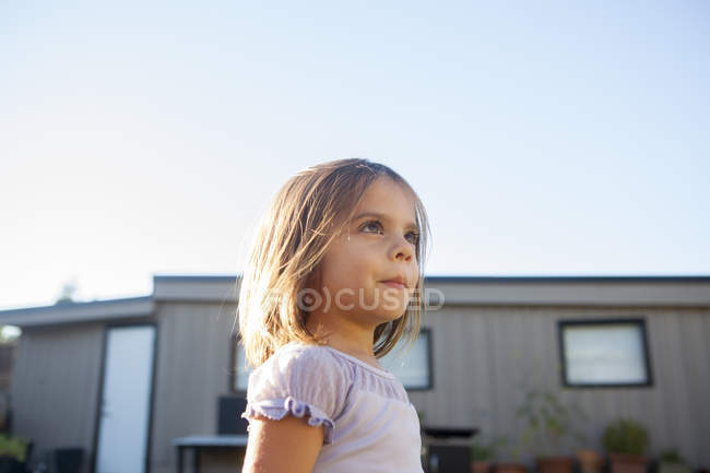 Curious girl looking away — Stock Photo