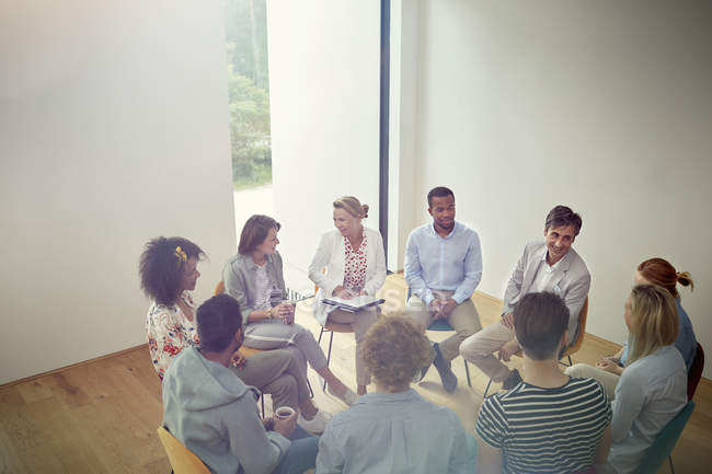 People talking in a circle in group therapy session — Stock Photo