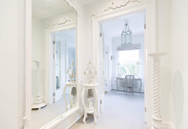 white luxury home showcase interior corridor with mirror stock