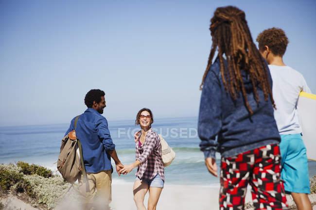 Multi-ethnic family on sunny summer ocean beach — Stock Photo