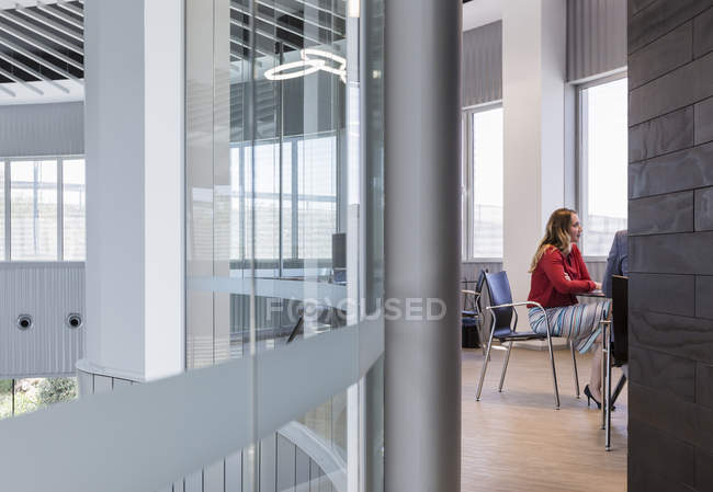 Businesswoman listening in modern conference room meeting — Stock Photo
