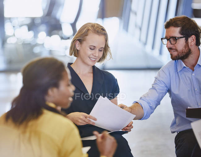 Business people discussing paperwork in meeting at modern office — Stock Photo