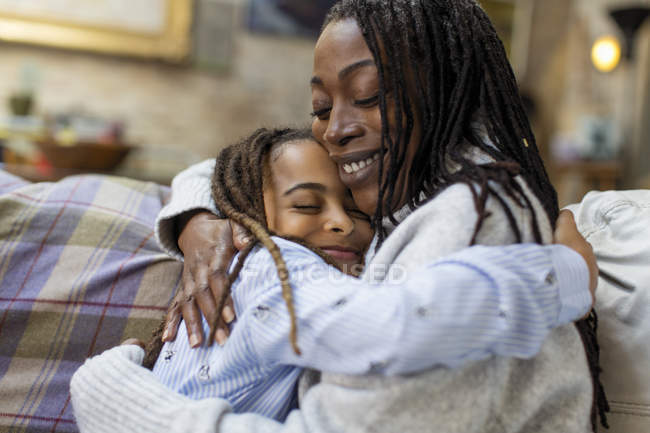 Affectionate mother and daughter hugging — Stock Photo