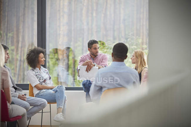 People talking in group therapy session — Stock Photo