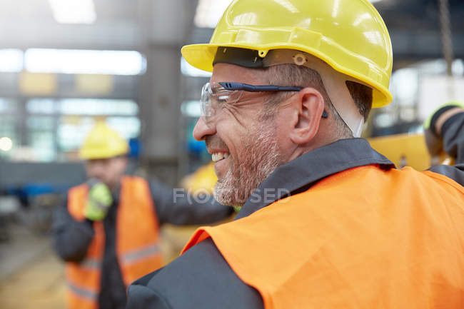Profile smiling male worker in factory — Stock Photo