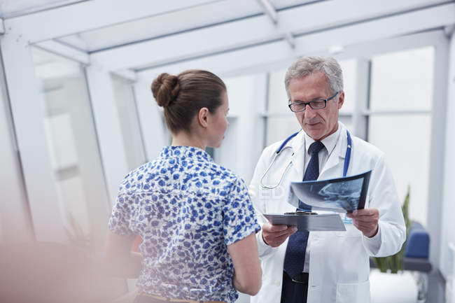 Doctor and nurse with x-ray talking in hospital — Stock Photo