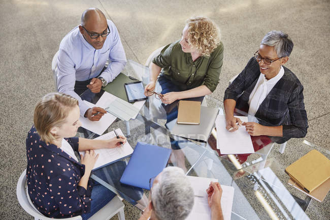Business people talking in meeting at modern office — Stock Photo