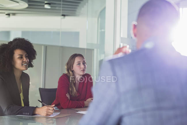 Attentive businesswomen listening in conference room meeting — Stock Photo