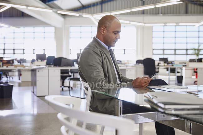 Businessman using digital tablet at modern office — Stock Photo