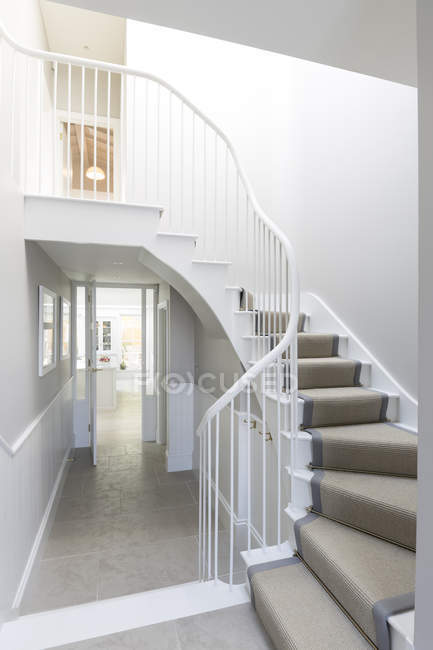 Luxury home showcase foyer with winding staircase — Stock Photo