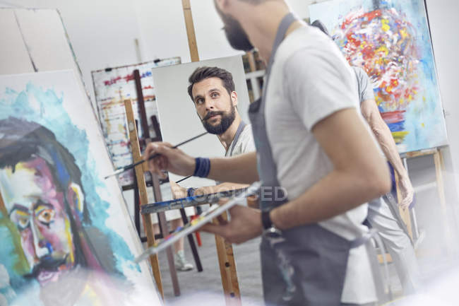 Male artists painting in art class studio — Stock Photo