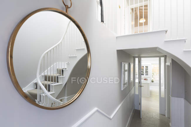 Reflection of foyer staircase in round mirror — Stock Photo