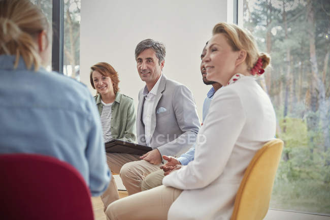 People listening in group therapy session — Stock Photo