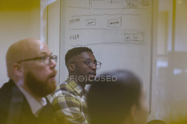 Attentive businessmen listening in conference room meeting — Stock Photo