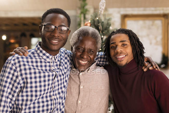 Portrait grandfather and grandsons hugging — Stock Photo