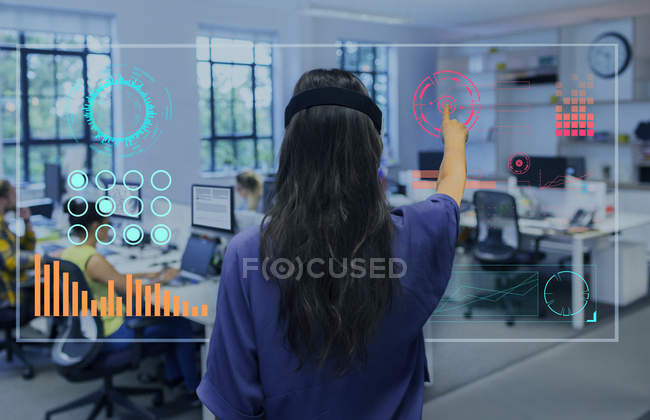 Businesswoman using futuristic hologram computer in office — Stock Photo
