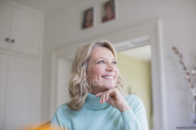 Smiling, ambitious mature woman looking away — Stock Photo