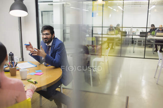 Creative businessman brainstorming in meeting — Stock Photo
