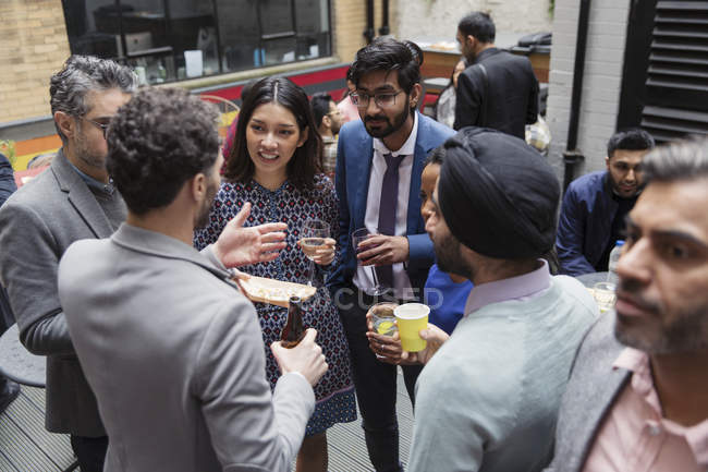 Friends drinking and socializing — Stock Photo