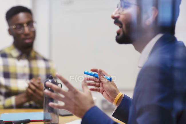 Businessman talking, explaining in meeting — Stock Photo