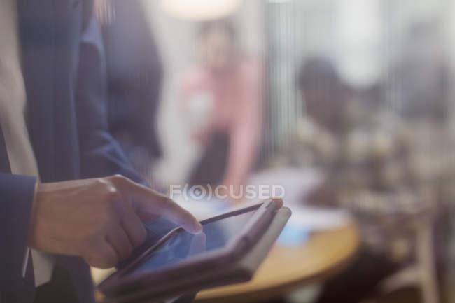 Close up businessman using digital tablet — Stock Photo