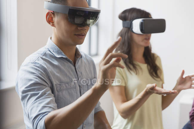 Computer programmers testing virtual reality simulator glasses — Stock Photo