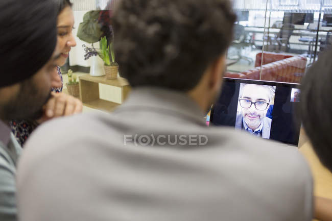Business people video conferencing at laptop in office — Stock Photo