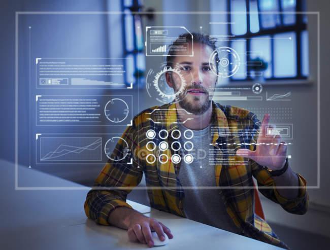 Businessman using futuristic hologram computer — Stock Photo