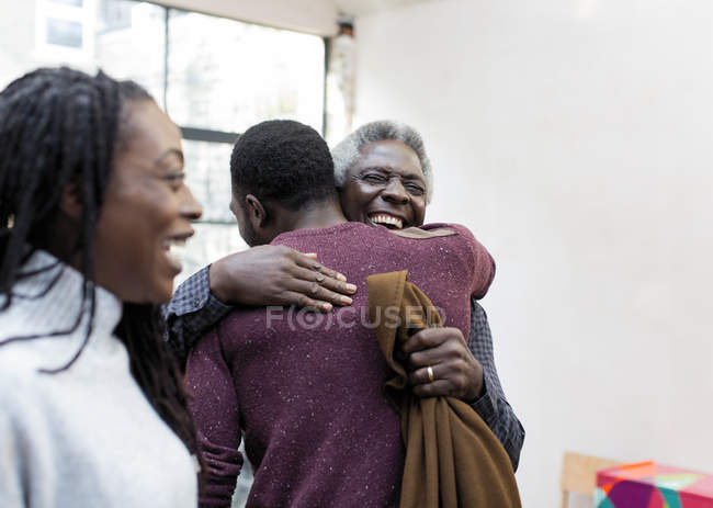 Happy grandfather hugging grandson — Stock Photo