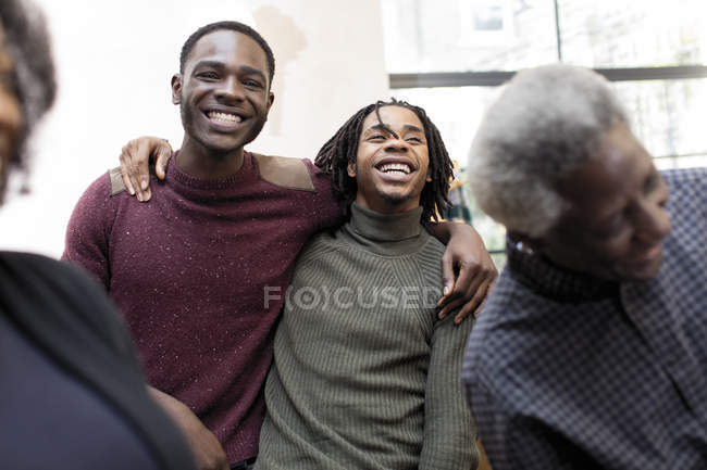 Happy brothers hugging indoors — Stock Photo