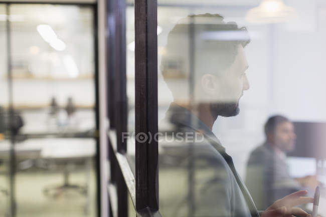 Businessman listening in conference room meeting — Stock Photo